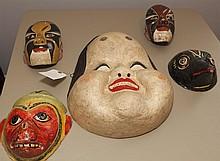 Five Asian papier-mache masks