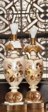 Pair of urn form table lamps, composition with gilt painted highlights, floral motifs, no shades