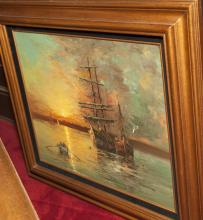 Canvas oil painting depicting ships at sea, gilt framed