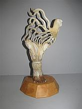 Figural Bone Carving on Wood Base By Clyde Drew