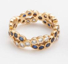 Sapphire, diamond and gold eternity band