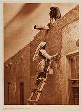 Edward Sheriff Curtis, American (1868-1952), Replastering a Paguate House, photogravure, on tissue,