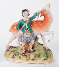 Staffordshire Figure of a Boy and a Stag