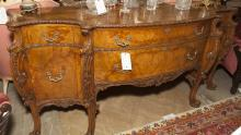 French Louis XV design sideboard having a pair of small drawers and cupboard doors flanking tow graduated long drawers