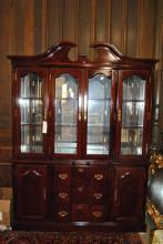 Two member mahogany china cabinet having broken pediment and brass drawer / door pulls