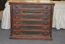 J & P Coats Spool Cotton six-drawer spool chest with brass pulls, original metal back with company logo and inscription on each draw...