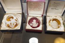 Three Baccarat crystal portrait paperweights; of Ernest Hemingway after Gilbert Poillerat sculpture,