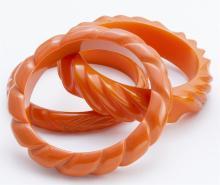 Orange bakelite bangle bracelets