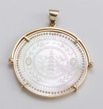 Chinese gambling chip and gold pendant