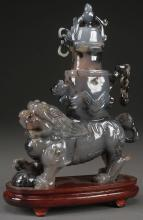 A CHINESE GRAY JADE FIGURAL URN