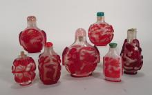 7 Chinese red overlay glass snuff bottles, 20th C.