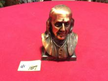 Benjamin Franklin heavy duty coin bank issued by the Franklin life insurance company