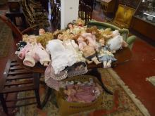 Large collection of porcelain headed dolls