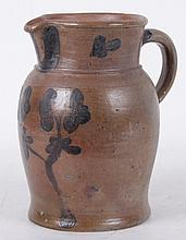 An American Stoneware Pitcher with Blue Decoration
