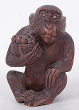 A Carved Wooden Monkey Form Inkwell