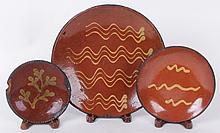 Three American Redware Plates, 19th century