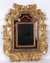 A Continental Gilt Courting Mirror