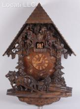 A Large 20th Century German Carved Wood Cuckoo Clock