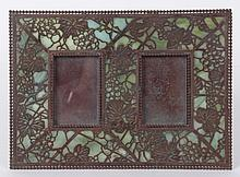 A Tiffany Studios Grapevine Pattern Bronze and Glass Frame