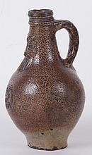 A 17th Century German Salt Glazed Stoneware Bellarmine Jug