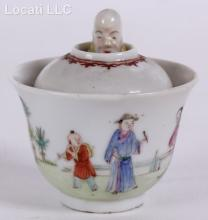 A Chinese Porcelain Trick Cup