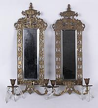 A Pair of Brass Mirrored Sconces