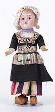 A Victorian Bisque Head Doll, Dutch Costume