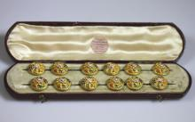 A Rare and  Fine set of 12 Gold Cased and Polychrome Enamel Buttons