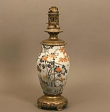 A Japanese Porcelain lamp with brass mounts. Early
