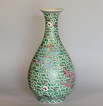 A Large Chinese Vase. 19th century. Decorated with a red Dragon