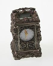 A Fine Silver Cased Miniature Carriage Clock