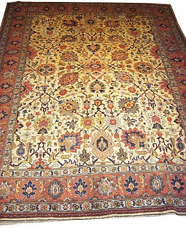 ANTIQUE TABRIZ CARPET, 395cm x 296cm, in the 'Shah