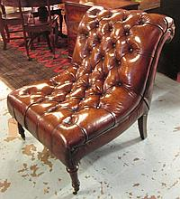 CLUB CHAIR, button upholstered tan brown leather with turned front supports