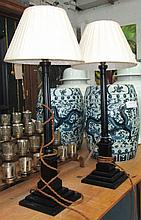 LAMPS, a pair, black columns with pleated silk shades, 75cm H. (2) (with fa