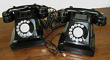 TELEPHONES, a pair, in black, decorative only, 23cm W. (2)