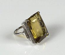 CITRINE AND DIAMOND DRESS RING, large mixed cut citrine shouldered by step