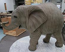 GARDEN ORNAMENT, of an elephant in grey resin, 114cm L.