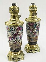 TABLE OIL LAMPS, a pair, adapted from Oriental ceramic famille rouge vases,