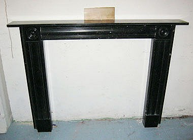 CHIMNEY PIECE, Regency style black marble with