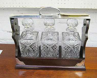 TANTALUS, with three crystal decanters in a