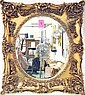 OVAL MIRROR, with bevelled plate, in ornate gilt classical frame, 86cm x 71cm.