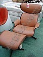 LOUNGE CHAIR, after Charles and Ray Eames, moulded plywood recently upholstered in tanned leather, with matching stool. (2)