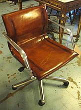 REVOLVING DESK CHAIR, tan hide leather on an adjus