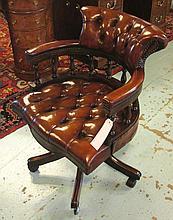 REVOLVING DESK CHAIR, tan hide leather upholstered