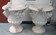 URNS, a pair, white painted reconstituted stone wi