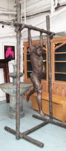 BRONZE BOY, on swing, realistically cast, 255cm H.