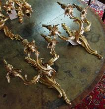 WALL SCONCES, a pair, each with three branches, gilt metal Rococo style, el
