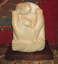 BERNARD MAGUIRE, 'Lady with child' carved in Portland stone, 45cm H.