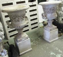 LARGE STONE URNS ON BASES, a pair, 118cm H. (2) (one with fault)