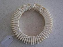 Antique ivory bangle with elephant head terminals measures 9.2cms Dia